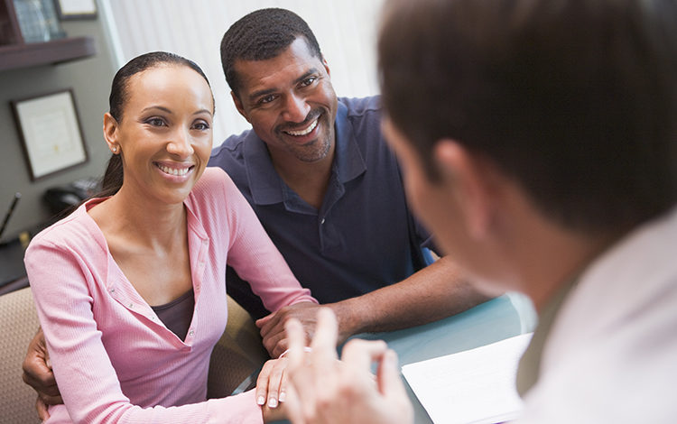 Couple consulting a fertility specialist.